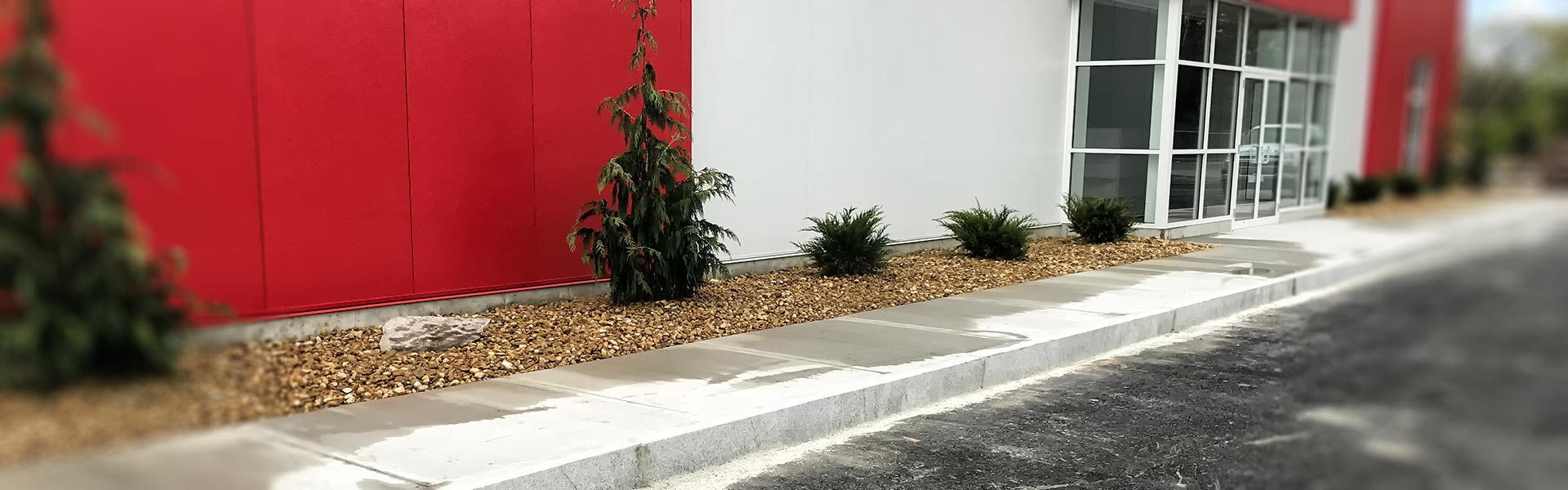 Commercial landscaping with stone and plantings